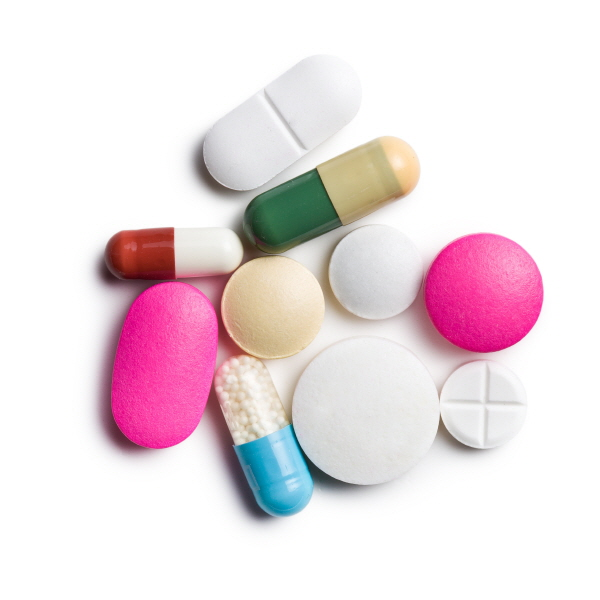 top view of colorful pills on white background